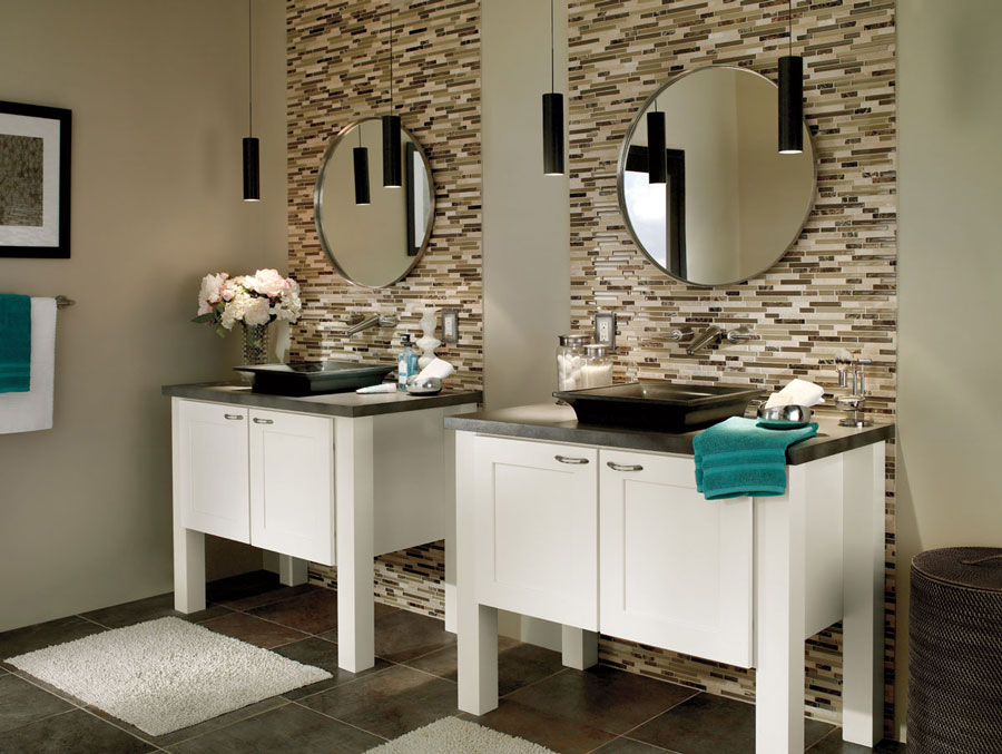 Photo showing custom vanity with modern cabinets and granite counters